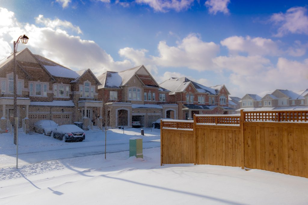 brown 2 storey houses during snow